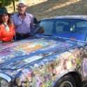 Donna Huggins and John Jamieson with Huggins' 1977 Rolls Royce Silver Shadow II, decorated for the Summer of Love with 1960s concert posters, photos, and rock star autographs she collected